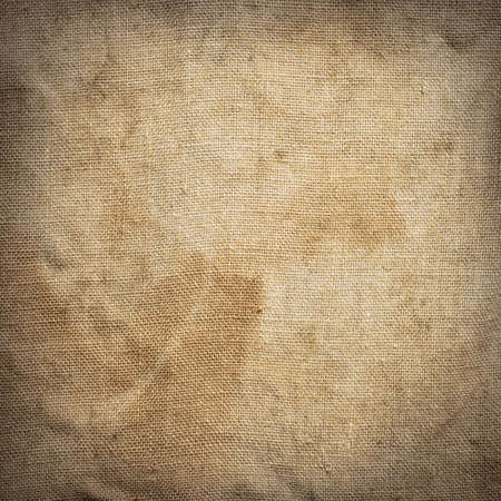 creasy: Old dirty brown creasy square burlap texture. Stock Photo