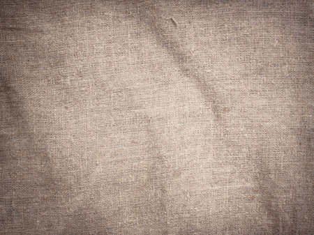 creasy: Old dirty brown horizontal creasy burlap texture.