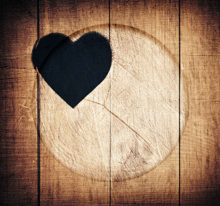 bark carving: Double exposure of heart shape and wooden circle.