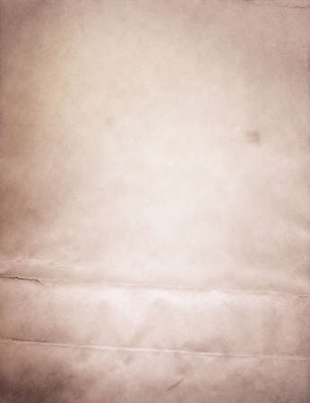 parchment texture: Light grunge brown recycled parchment with stains, paper texture.