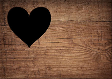 bark carving: Heart shape cut on wooden wall, toilet, wc door or window. Stock Photo