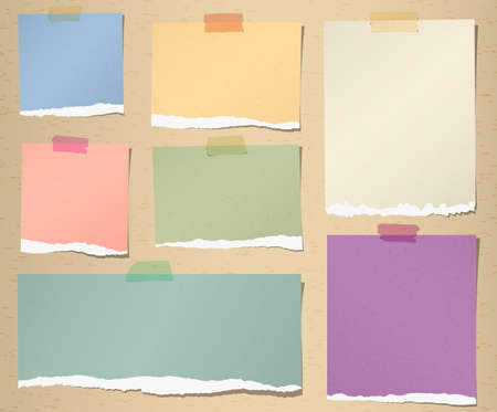 Set of various colorful torn note papers with adhesive tape on brown background.