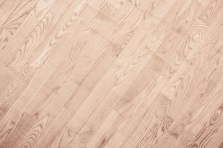 Brown parquet floor, wooden texture with diagonal planks.