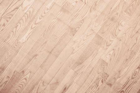 Brown parquet floor, wooden texture with diagonal planks.