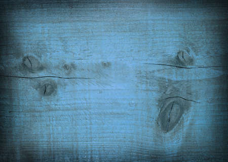 Dark blue scratched wooden plank. Wood texture.
