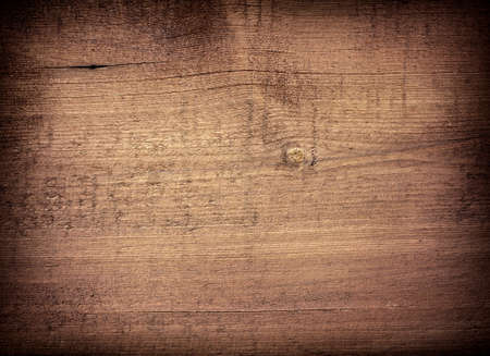 Dark brown scratched wooden cutting board. Wood texture. 免版税图像 - 52074546