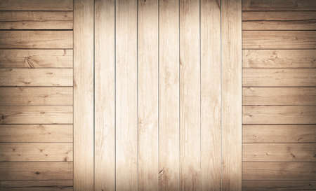Light brown wooden wall, plank floor surface.
