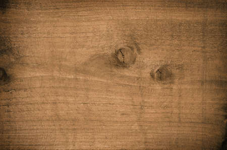 board panel: Dark brown scratched wooden cutting board. Wood texture.