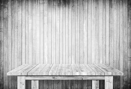 Empty gray table next to wooden wall. Foto de archivo