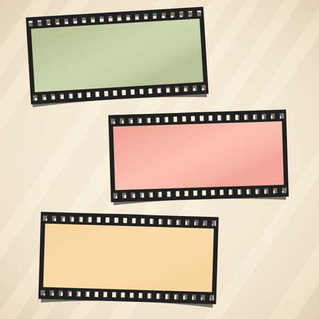 camera film: Colorful film or camera strips on light striped brown background.