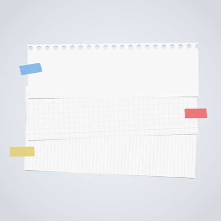 Pieces of cut white squared, lined notebook paper are stacked on gray background.