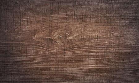 Dunkelbraun zerkratzt Holzbrett. Wood texture.