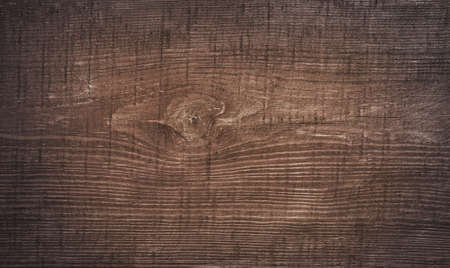 wooden boards: Dark brown scratched wooden cutting board. Wood texture.