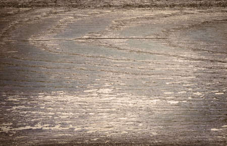 scratched: Dark gray scratched wooden plank. Wood texture.