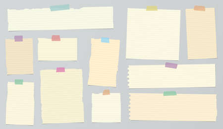 ruled paper: Pieces of light brown ruled torn note paper with colorful adhesive, sticky tape are stuck on background.