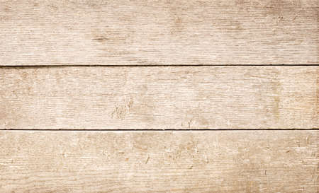 chops: Light brown scratched wooden planks, wall, table, ceiling or floor surface. Wood texture.