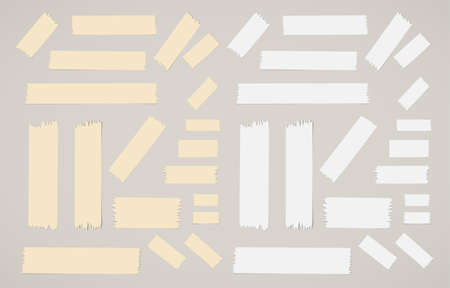 masking: Pieces of different size sticky, adhesive masking tapes are on gray background.