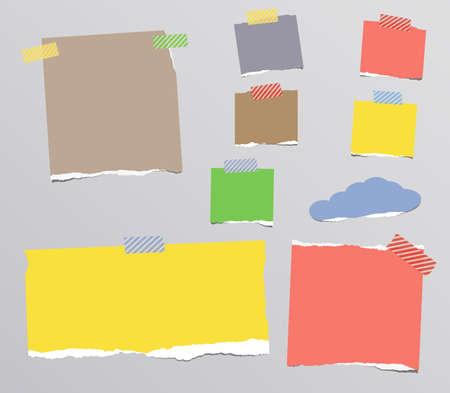 papel de notas: Arrancado del cuaderno de colores, papel de nota pegada en el fondo gris.