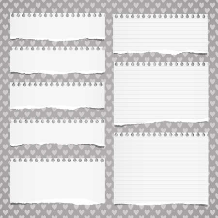 Ripped white ruled notebook, note paper stuck on pattern created of heart shapes.