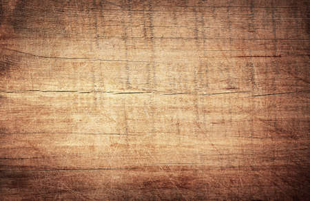 Brown scratched wooden cutting board. Wood texture