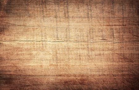 갈색 긁힌 된 나무 커팅 보드입니다. 나무 질감