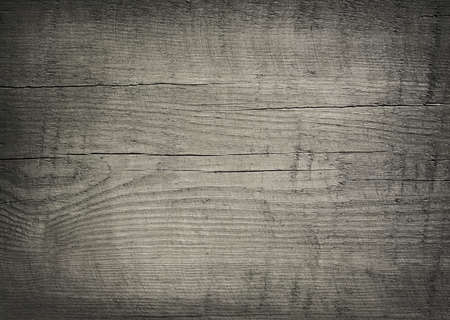 Gray dark scratched wooden cutting, chopping board. Wood texture.