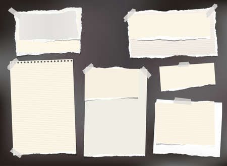 Beige ripped paper, notebook sheets, note paper for text or message stuck with sticky tape on black background.