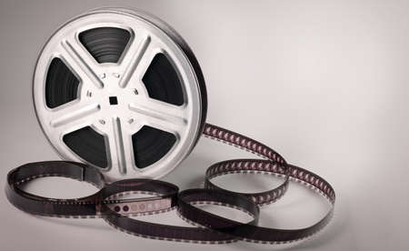 Old motion picture film reel on brown background