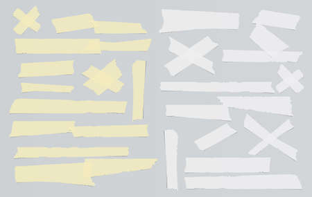 White and yellow adhesive, sticky, masking, duct tape, paper strips pieces for text on gray background