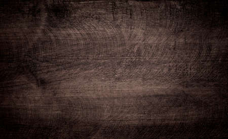 Dark brown grunge scratched wooden cutting, chopping board. Wood texture