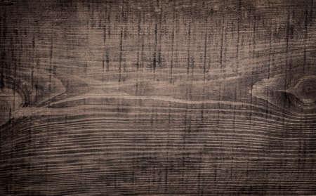 Coupe en bois rayé grunge gris foncé, planche à découper. Texture du bois