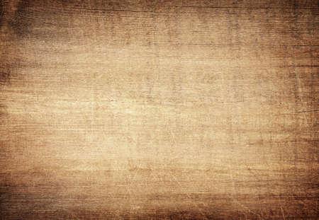 Braunes zerkratztes Holzschneidebrett. Holz Textur.