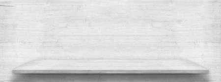 White wooden table top or shelf is near white wooden wall
