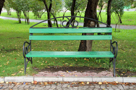 Green bench in autumn park Stock Photo - 22141076