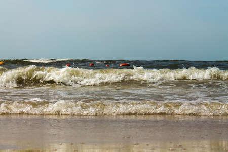 Sandy beach Baltic Sea. Beach sunset. Waves on the sandy beach.