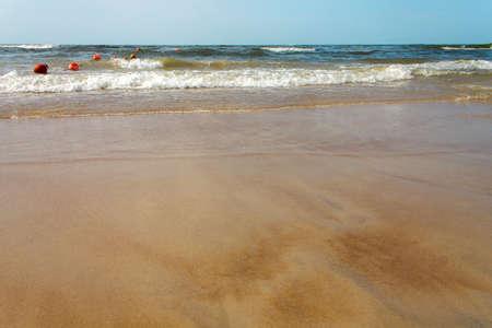 Sandy beach Baltic Sea. Waves on the sandy beach.
