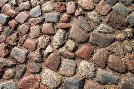 Cobblestone road. Multicolored cobblestone texture. 免版税图像