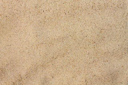 Texture quartz sand closeup. Sand on beach. Image for illustrators.