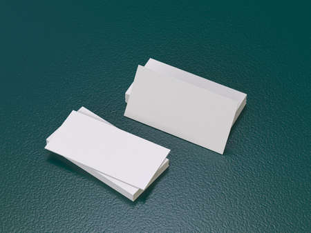 Blank business cards stacked up on a desk - insert your own design. 3D rendering