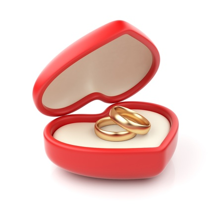 Gold wedding rings in valentine box 3D. Isolated on white background photo
