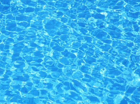 Swimming pool water. Aqua texture Standard-Bild