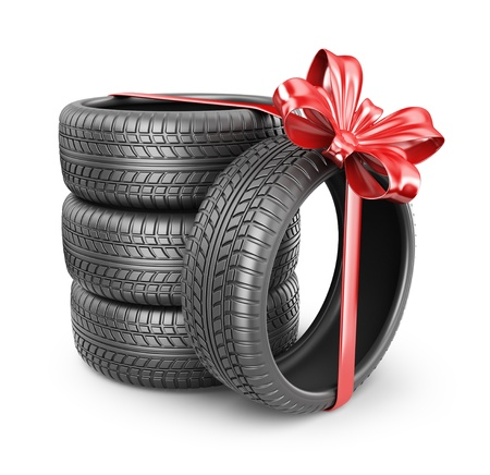 tire shop: Tyres with a red ribbon Stock Photo