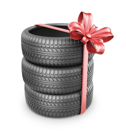 Tyres with a red ribbon. Present. 3D Icon isolated on white background photo