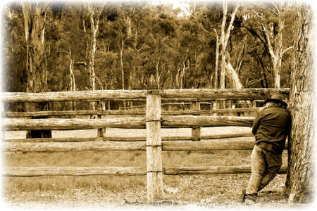 stockman: Quiet contemplation bushie style in Outback Australia in faded antique