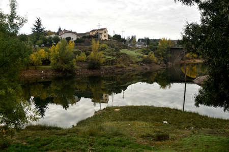 Buitrago Lozoya River passing through. Autumn reflections. Madrid's community. Spain.