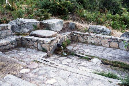 toilet: Source on the road to Los Almorchones. Becerril de la Sierra. Madrids community. Spain