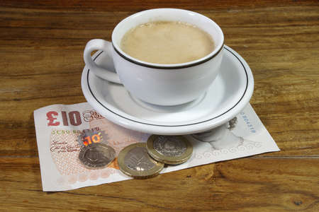 gratuity: Espresso With British Money  Stock Photo
