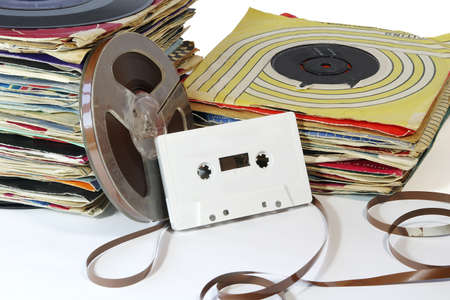 vinyl: Vintage Records with Tape Reel and Cassette.