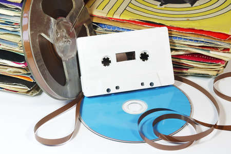 cassette: Vintage Records and Tape with a CD and Cassette. Stock Photo
