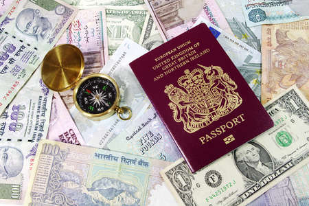 Passport , Compass and Various Currencies photo
